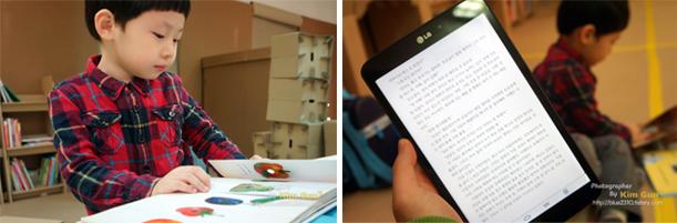 아이가 앉아서 책을 보고 있고 아빠는 G Pad 8.3으로 독서를 하고 있는 모습이다.