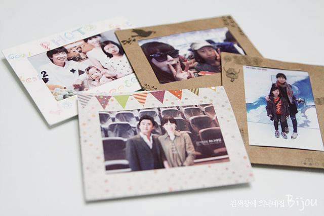 폴라로이드 사진 케이스를 이용해 포켓포토에서 인화한 사진을 다양하게 꾸며 놓은 모습이다.