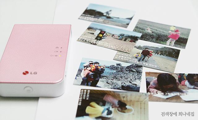 LG 포켓포토와 포켓포토로 출력된 여러 장의 사진들이 보인다.