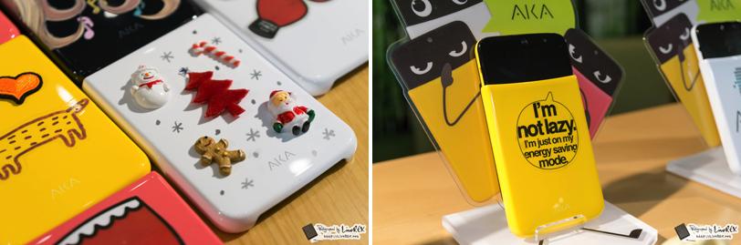 "LG 아카 스마트폰의 커버를 꾸민 모습. 하얀 바탕에 산타와 트리 등이 보인다.(왼쪽) 노란 바탕에 ""I'm not lazy"" 문구가 보인다.(오른쪽)"