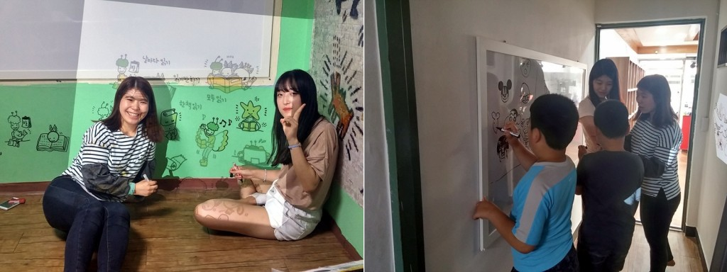 미니빔을 활용해 벽에 그림을 그리고 있는 LG Life's Good 봉사단과 아이들