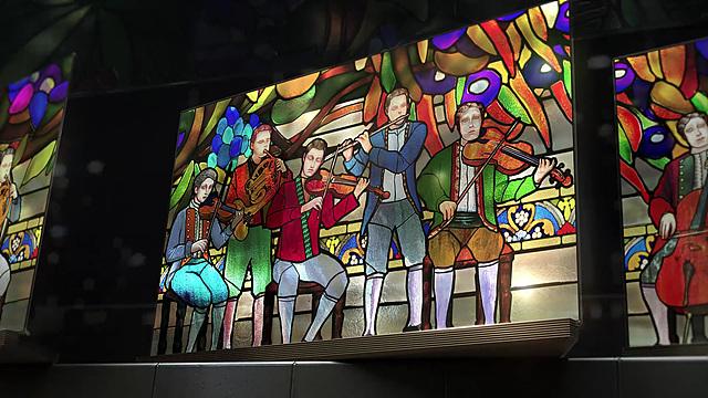 lg 시그니처 올레드 tv에 보여진 남자 다섯명이 악기를 연주하고 있는 모습