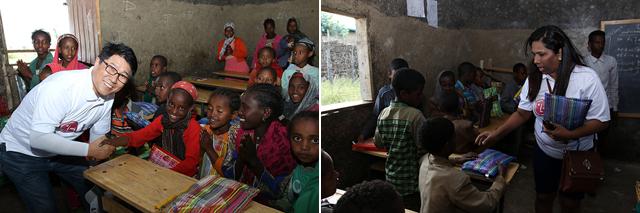 LG 희망마을 인근 두기데데라 초등학교에서 책가방과 문구류를 나눠주고 있는 봉사자들